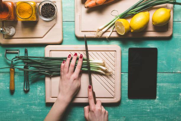 Cutting fresh vegetables stock photo