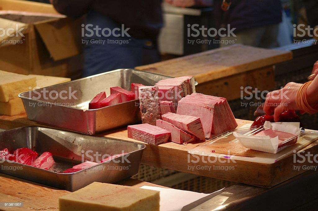 Cutting frozen fish royalty-free stock photo