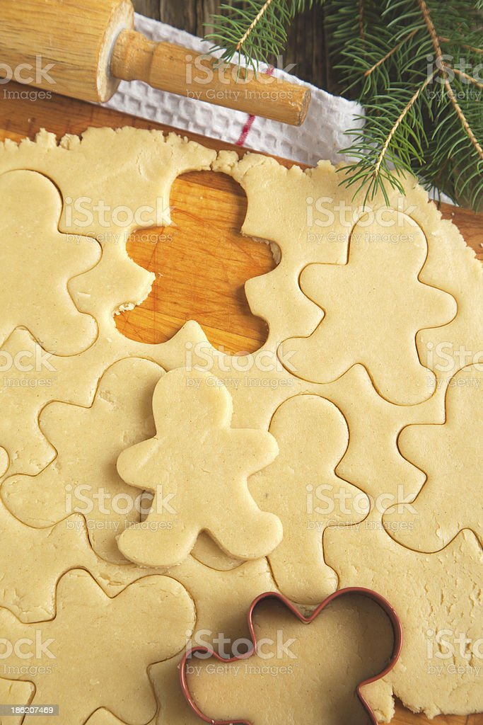 Cutting gingerbread cookies dough homemade for Christmas stock photo