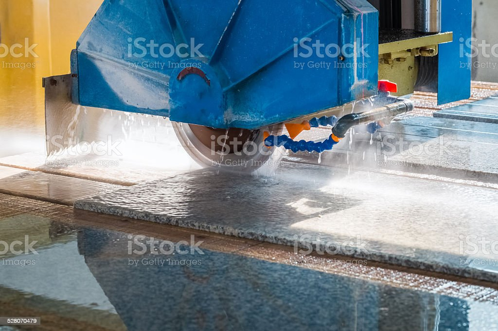 cutting granite closeup stock photo