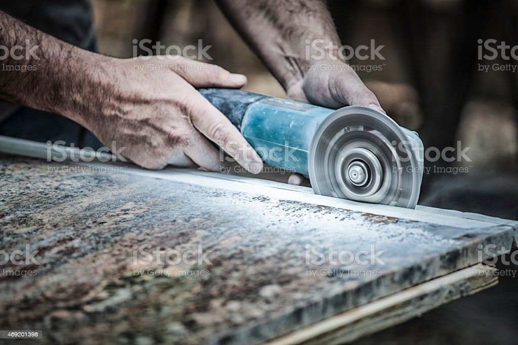 Cutting Granite stock photo