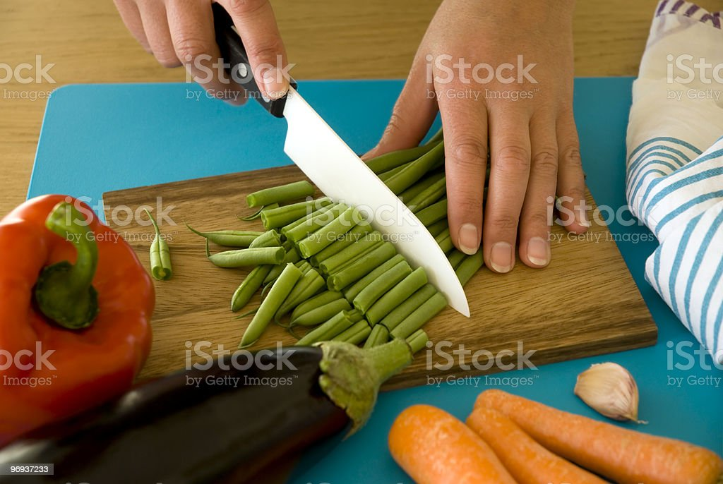 Cutting green beans royalty-free stock photo