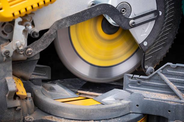 Cutting Hardwood Flooring with Miter Saw stock photo