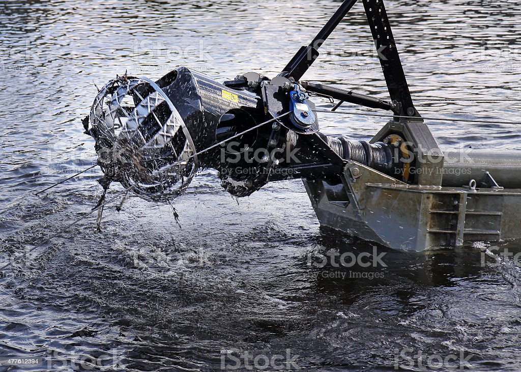 Cutting head of a floating suction cutter dredger stock photo