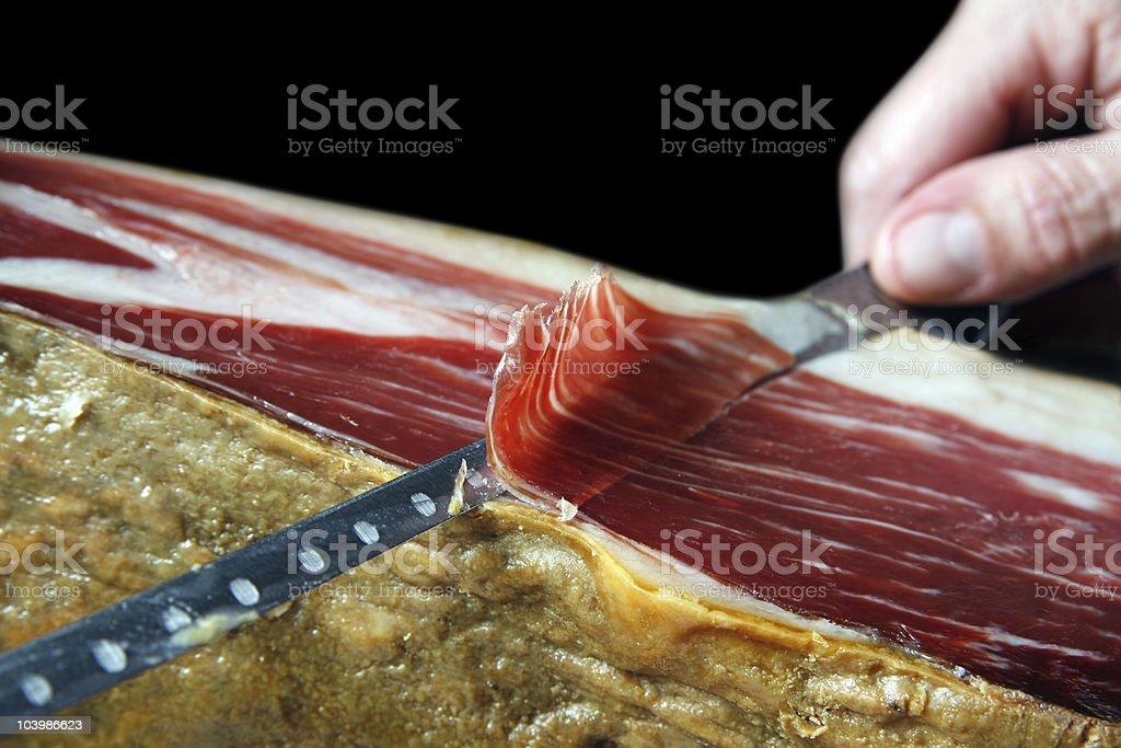 Cutting iberian ham stock photo