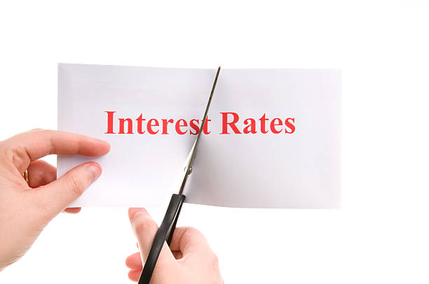 cutting interest rates - interest rate stock photos and pictures