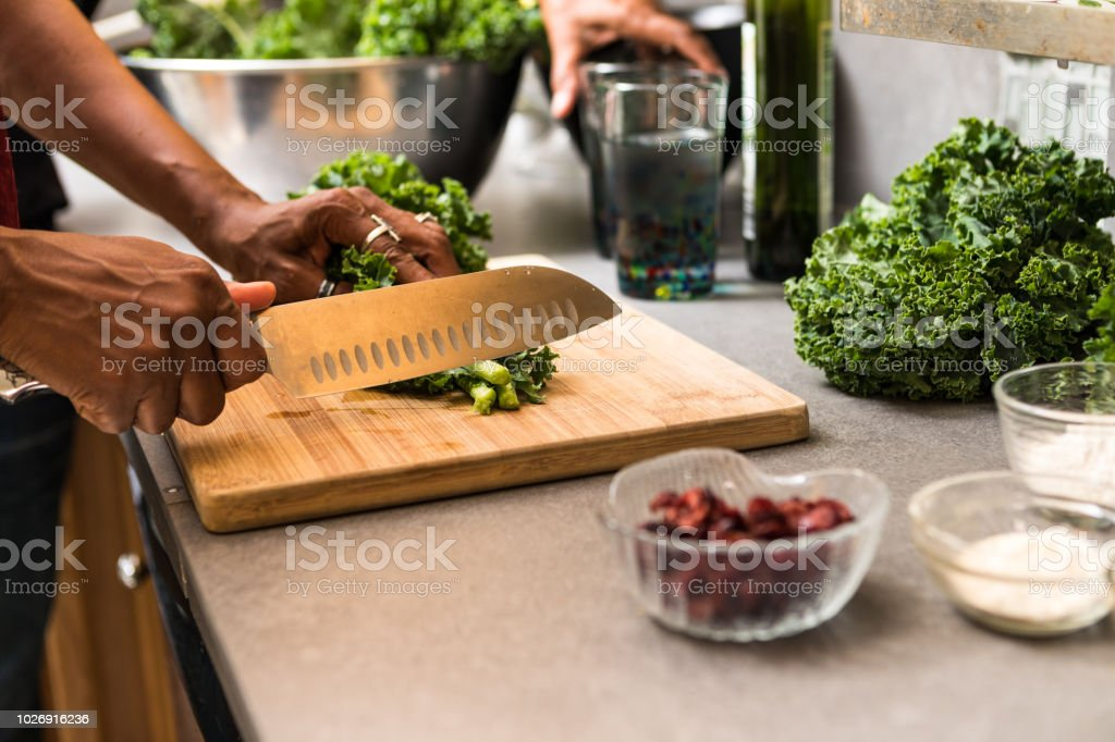 cutting kale on the cutting board stock photo