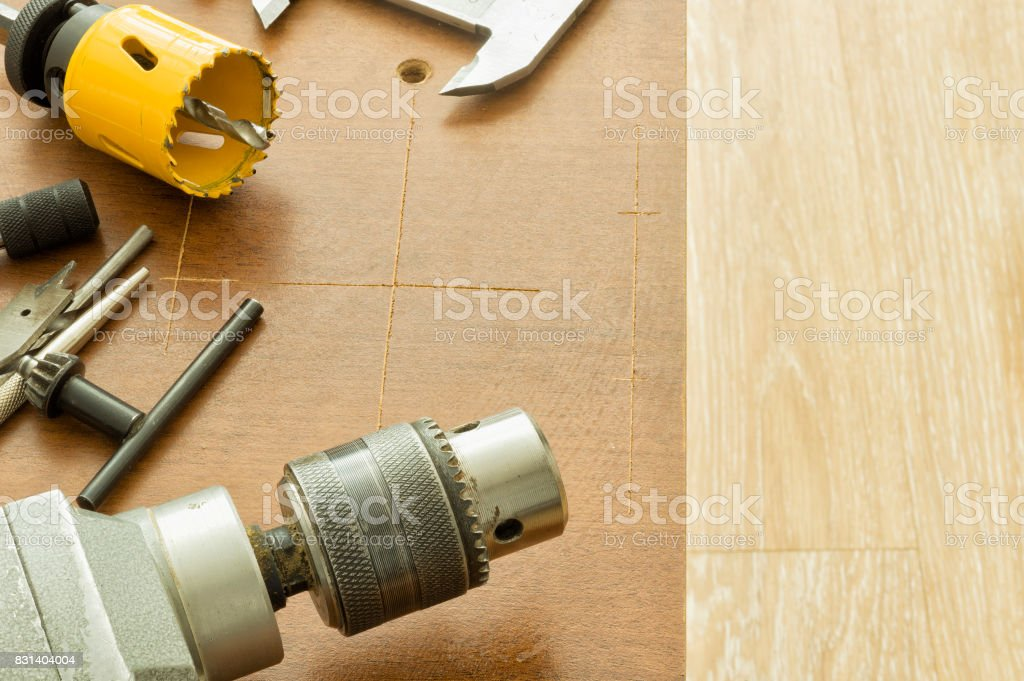 Cutting large holes with the aid of electrical instruments stock photo