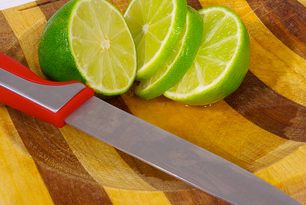 cutting limes - mikefahl stock pictures, royalty-free photos & images