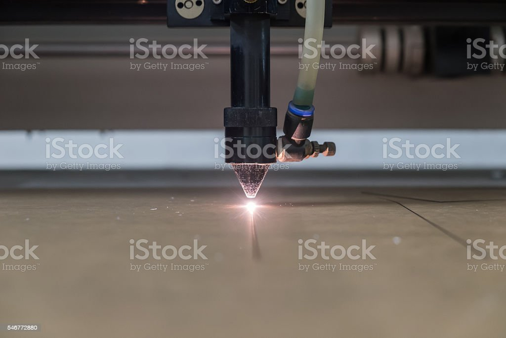 cutting machine carving patterns on the plastic plate stock photo