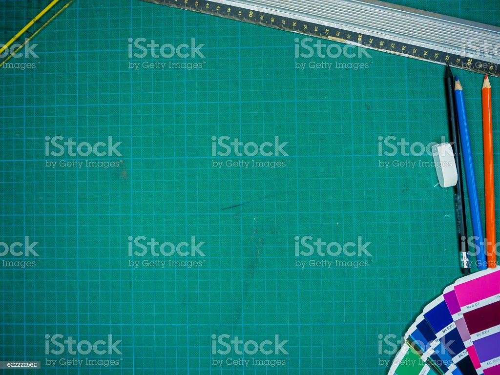 Cutting mat with various stationary tools, shot from above stock photo