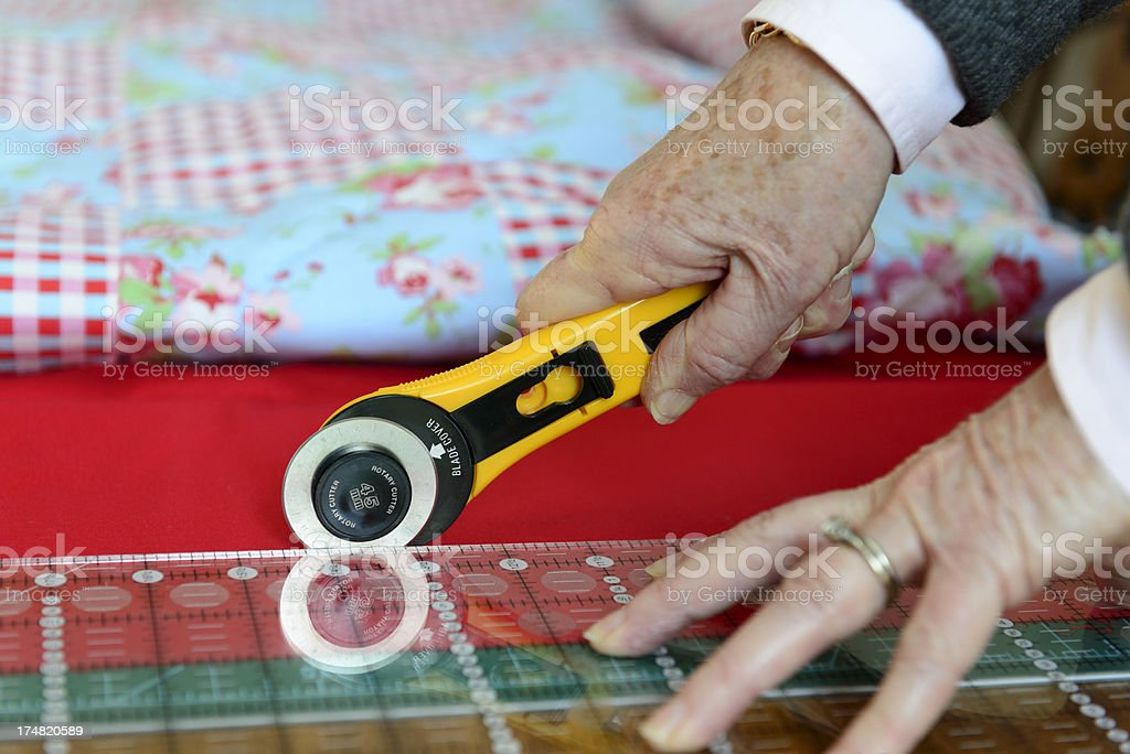 Cutting material with rotary blade cutter royalty-free stock photo