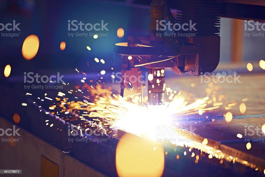Cutting metal by plasma laser stock photo