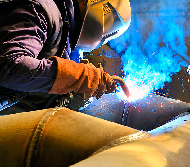 Cutting metal with mig welder stock photo