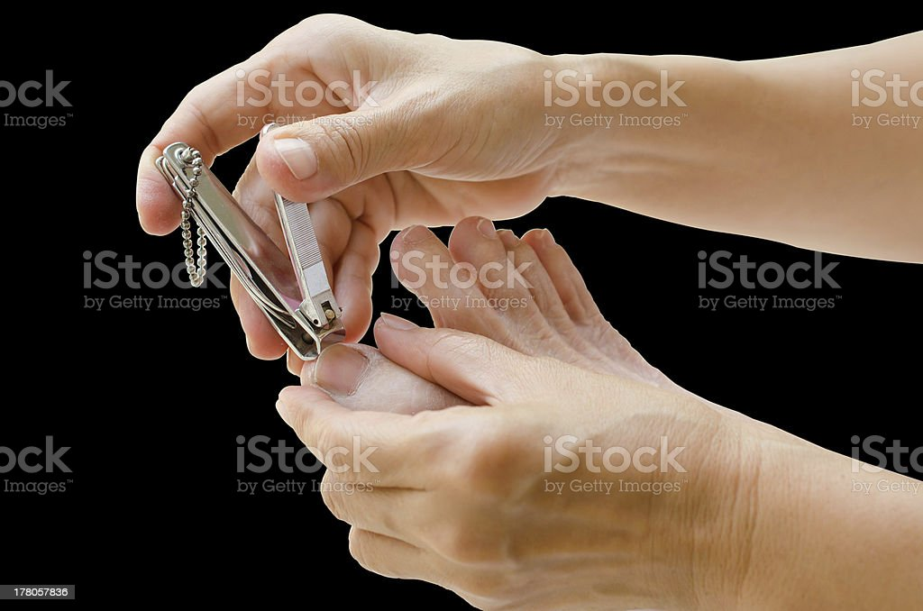 Cutting nails. stock photo