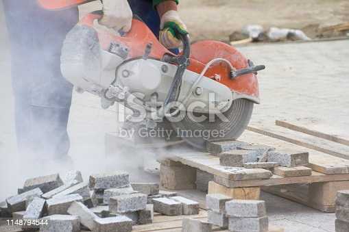 istock cutting of a stone on building by the electric machine with a diamond disk 1148794544