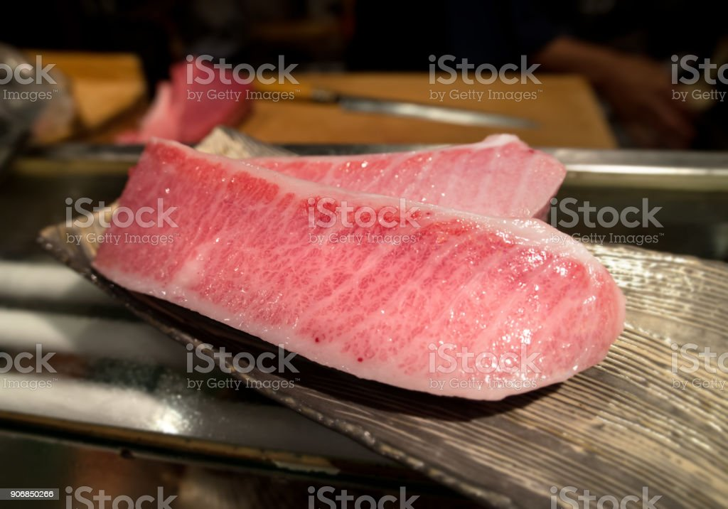 cutting of otoro from blue fin tuna for sashimi. stock photo