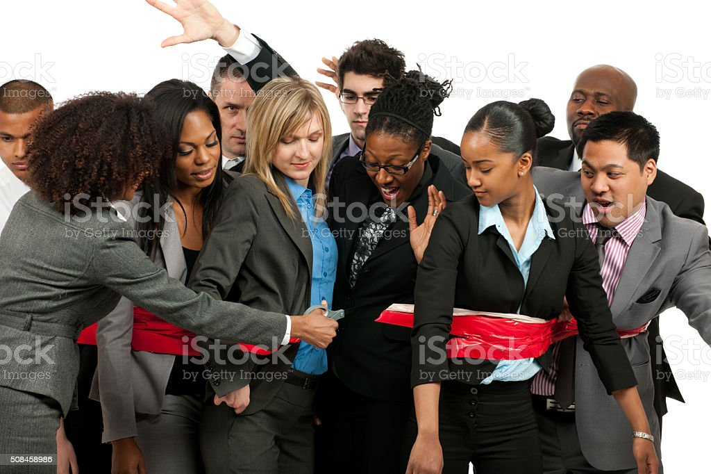 Cutting of red tape stock photo