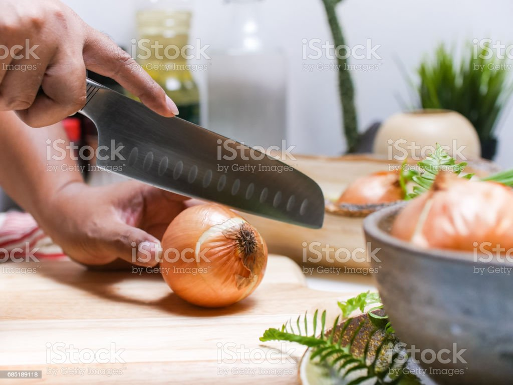 cutting Onion in kitchen royalty-free stock photo