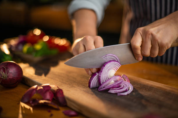cutting onions - cutter stock pictures, royalty-free photos & images