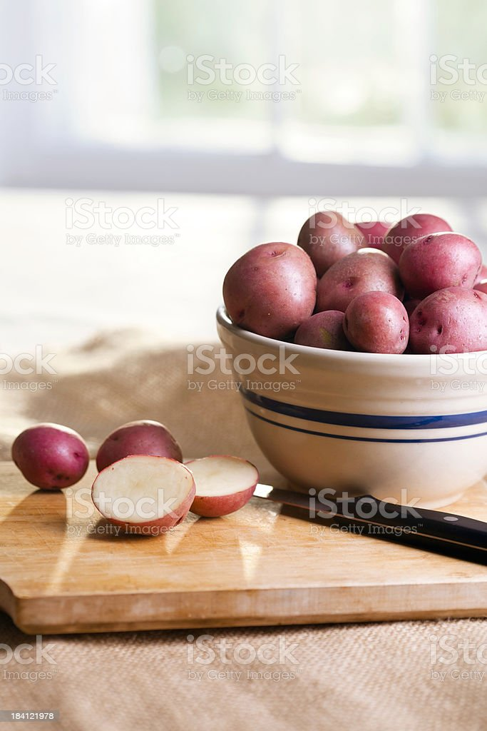 Cutting Potatoes stock photo