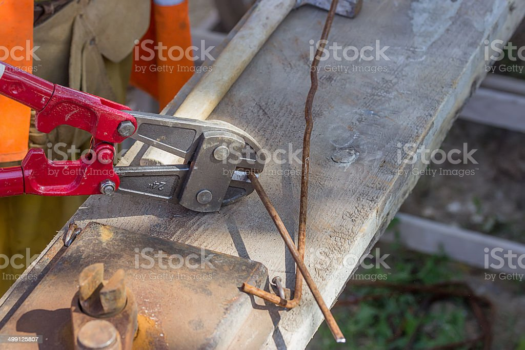 Cutting rebar with bolt cutters royalty-free stock photo