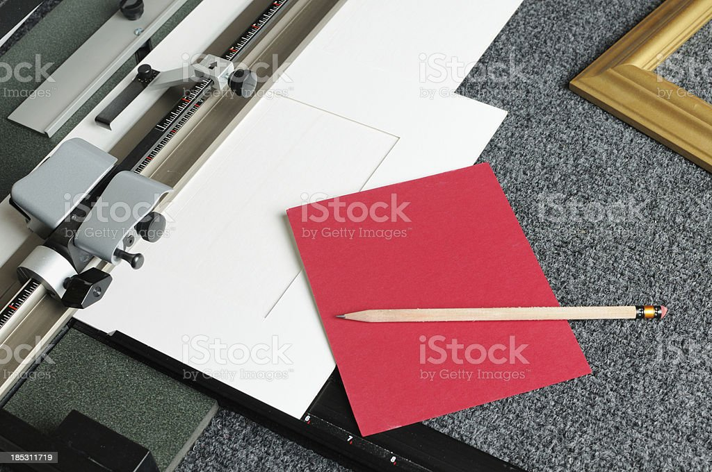 Cutting red mat board for picture frame stock photo