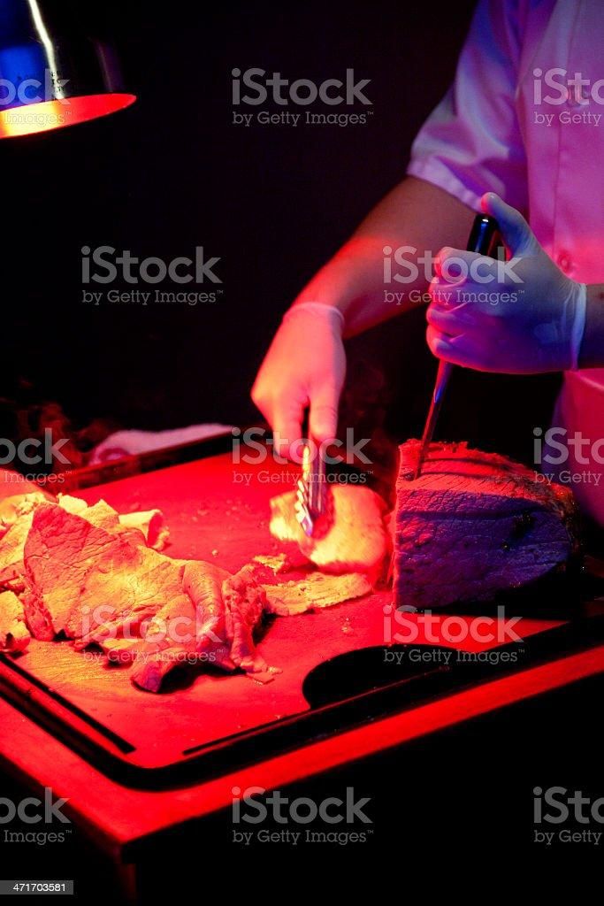 Cutting Roast Beef royalty-free stock photo