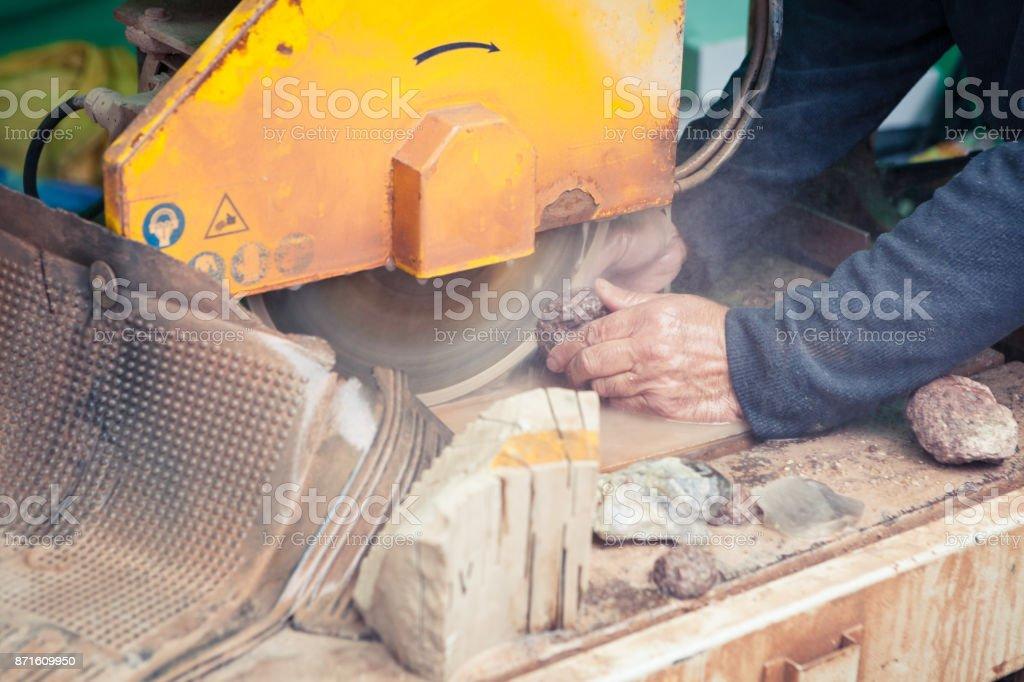 Cutting semiprecious agate stone stock photo