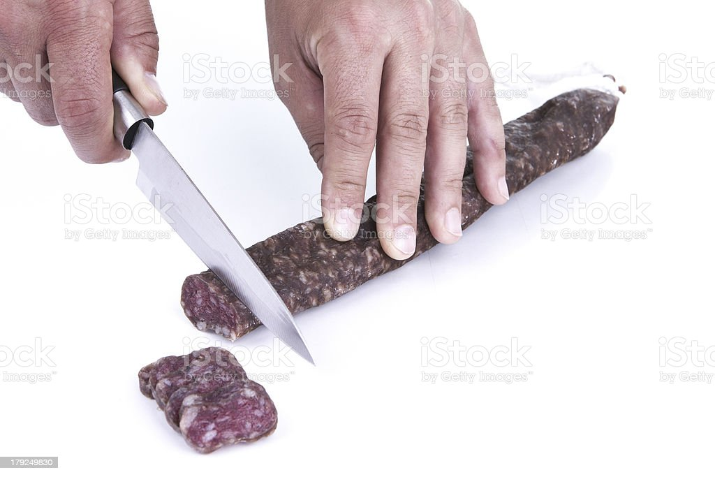 Cutting spanish sausage royalty-free stock photo