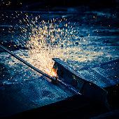 Oxy acetylene cutting of steel girders on  a demolition site