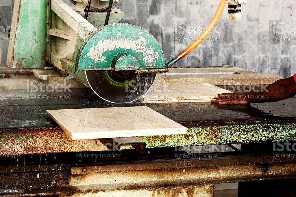 Cutting Stone tiles stock photo