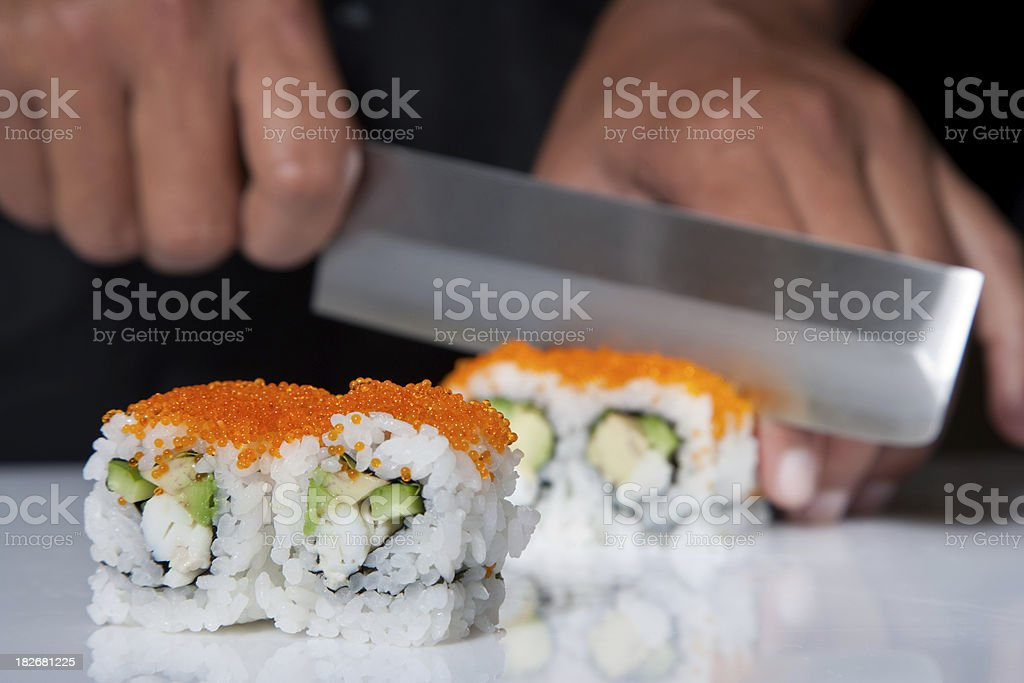 Cutting Sushi Rolls stock photo