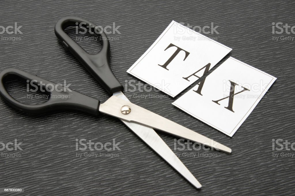 Cutting tax concepts stock photo