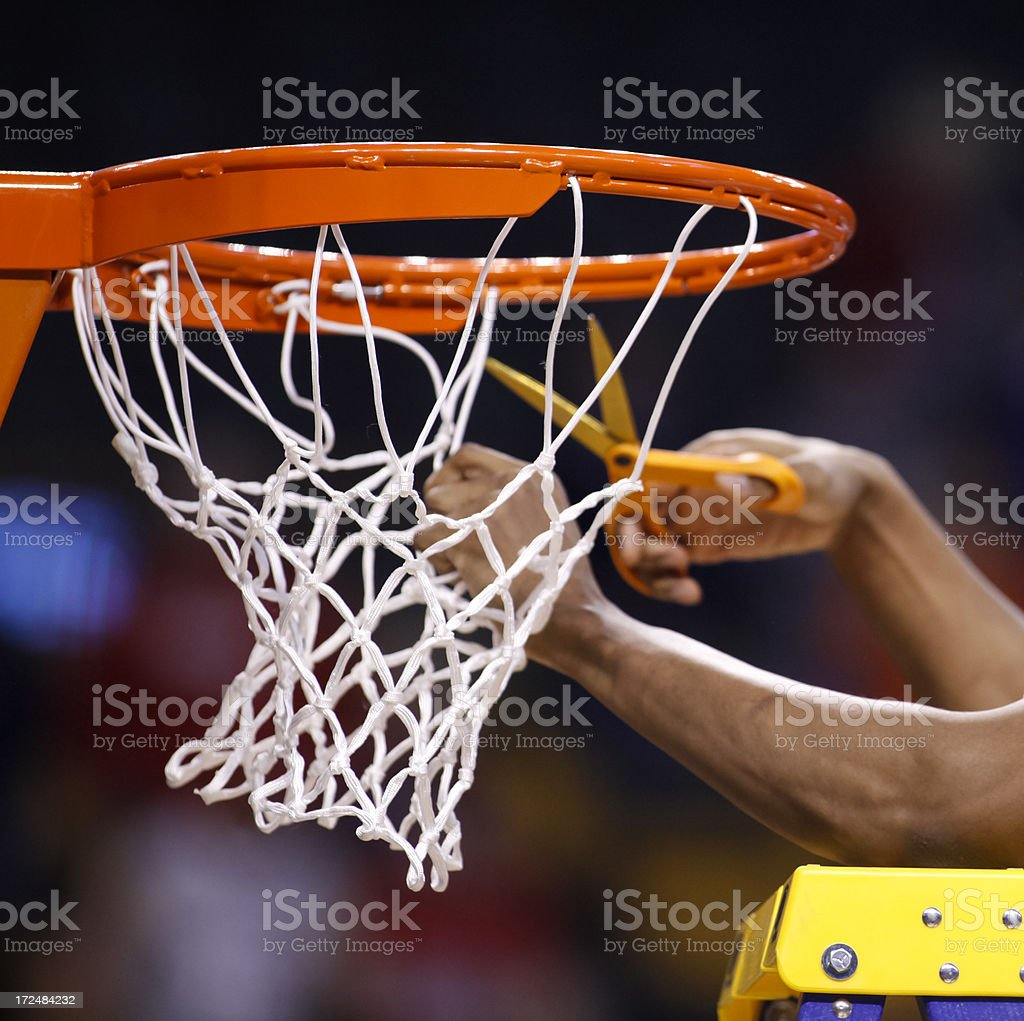 Cutting the basketball net down stock photo