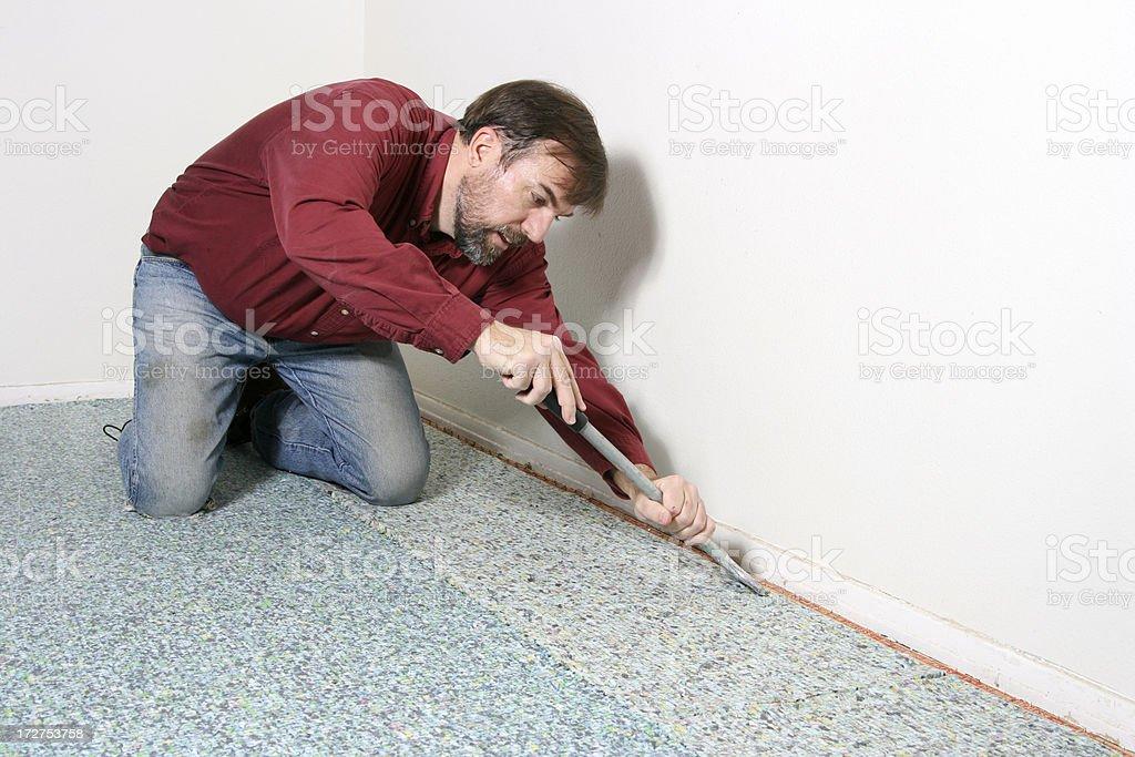 Cutting the Carpet Pad stock photo