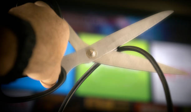 cutting the cord on cable tv - cutter stock pictures, royalty-free photos & images