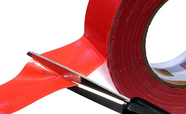 Cutting Through The Red Tape stock photo