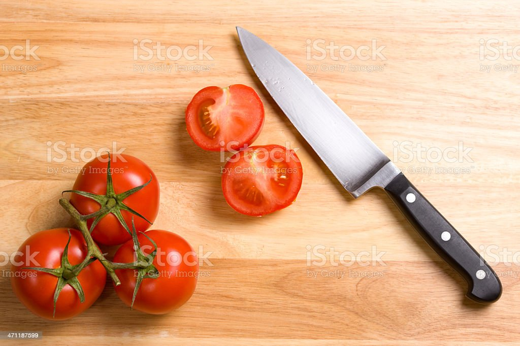 cutting tomatoes royalty-free stock photo