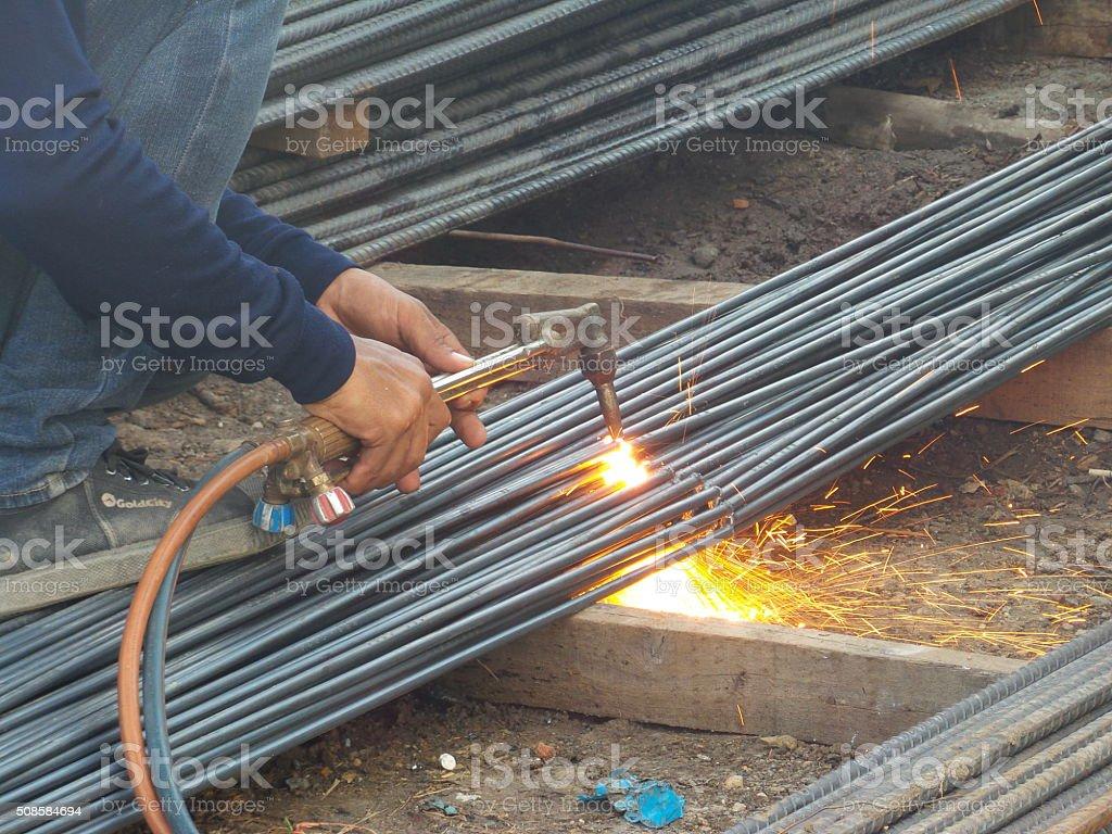 Cutting torch to cut rebar stock photo