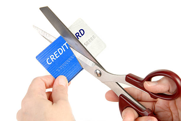 Cutting up Credit Card with scissors stock photo