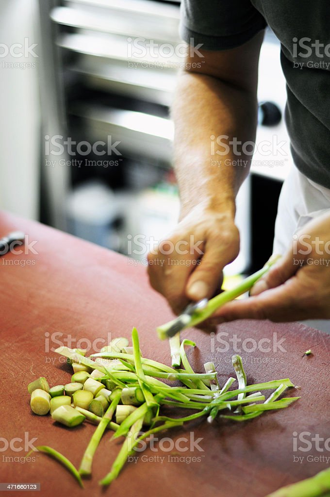 Cutting vegetables in a kitchen royalty-free stock photo