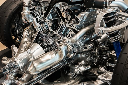 518201052istockphoto Cutting view of engine and transmission of automobile 1048664406