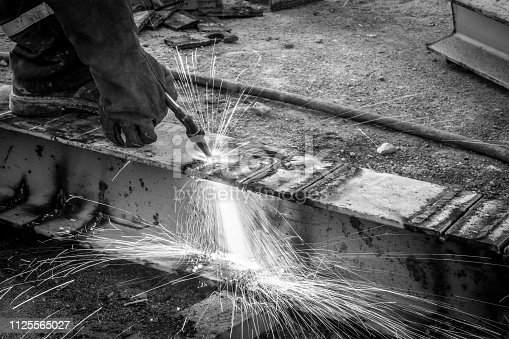 Blowtorch on construction site, black and white photography