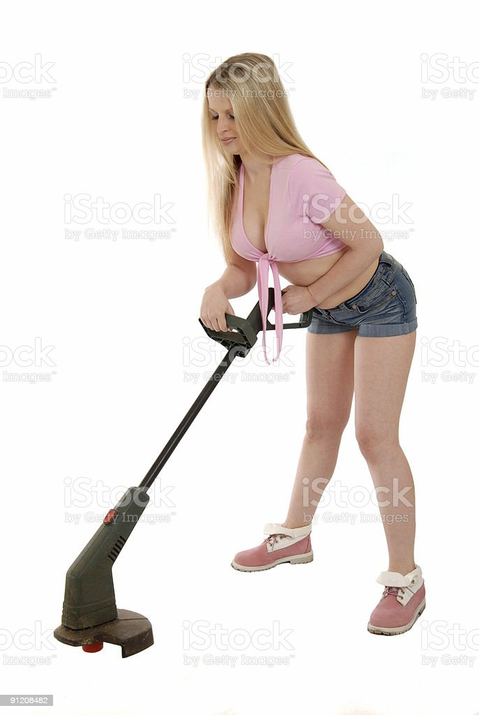Cutting with strimmer stock photo
