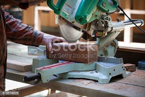Man cutting wood with circular saw