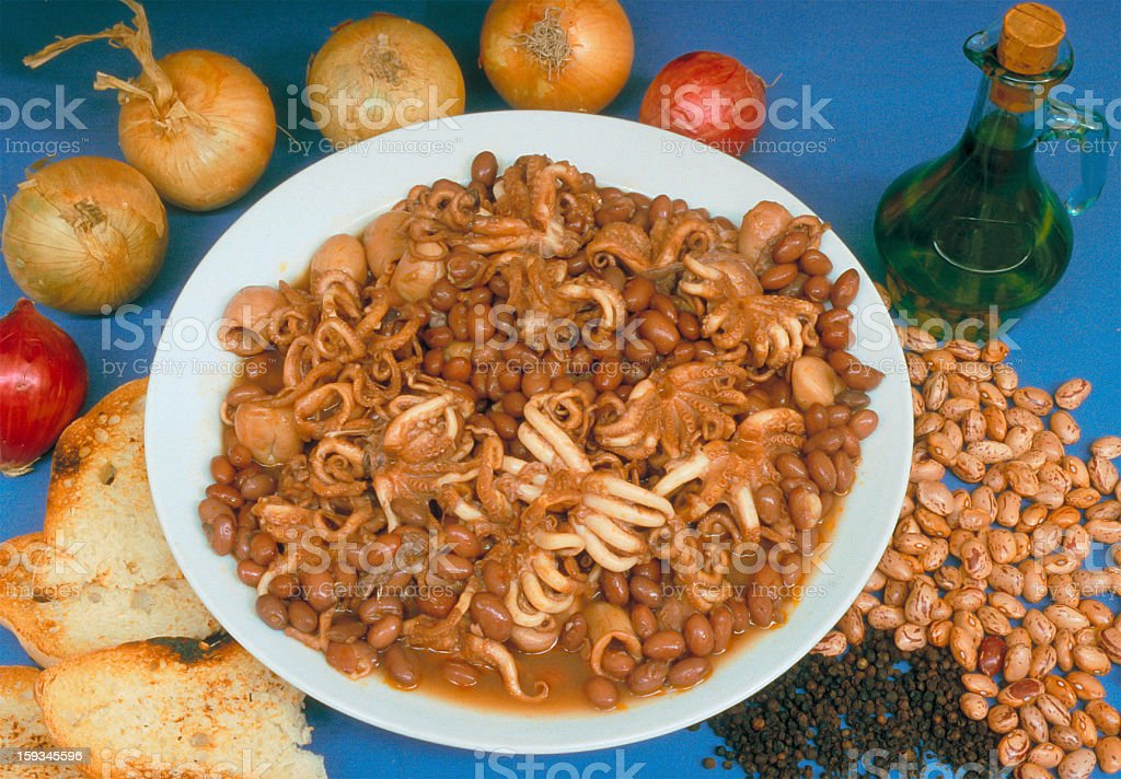 Cuttlefish and beans, traditional dish of southern Italy, with ingredients stock photo