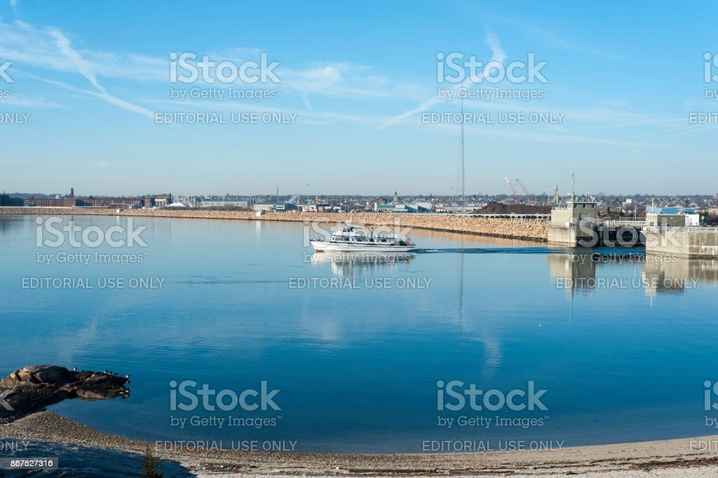 Cuttyhunk Ferry with hurricane barrier in background stock photo