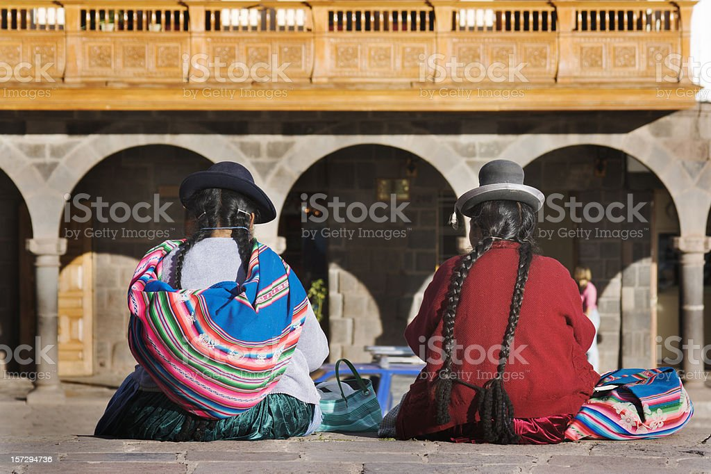 Cuzco, Peru—Indigenous Latin American Women Sitting in Traditional Clothing royalty-free stock photo