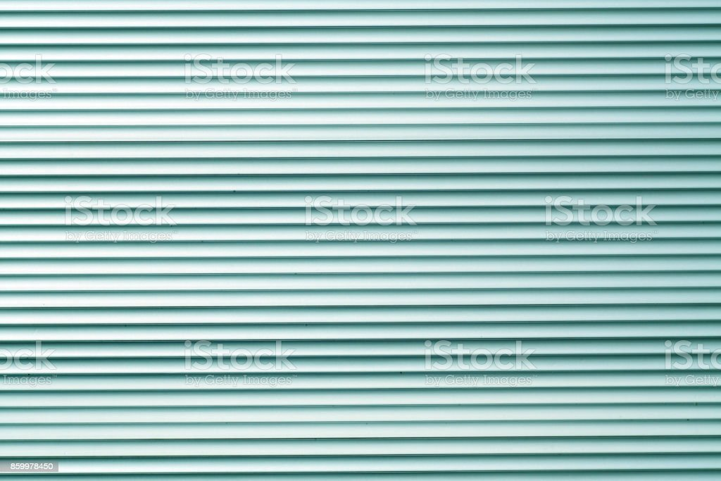 Cyan color metal warehouse wall pattern stock photo